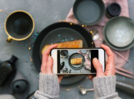 Canva-Female-hands-taking-pictures-for-Instagram.-Food-Blogger-concept-scaled